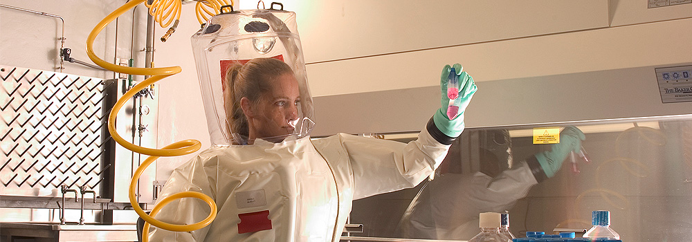 Woman in biohazard suit working in the lab