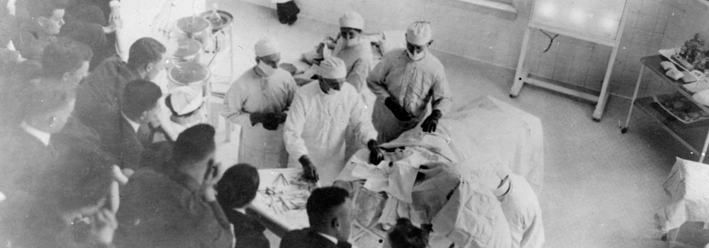 Vintage image of students watching surgery