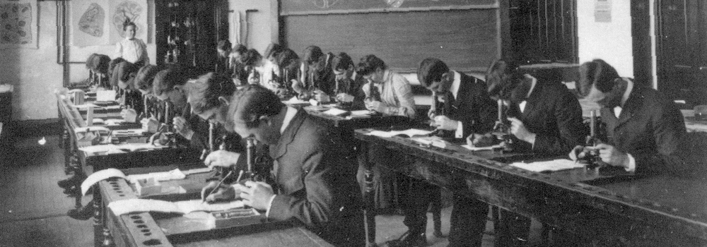 Vintage image of students looking in microscopes